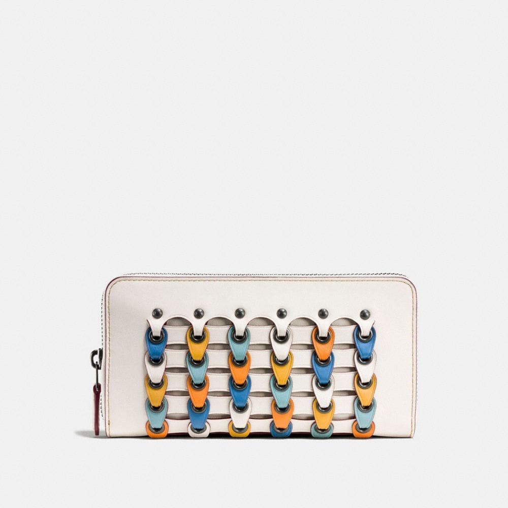 accordion zip wallet with colorblock coach link