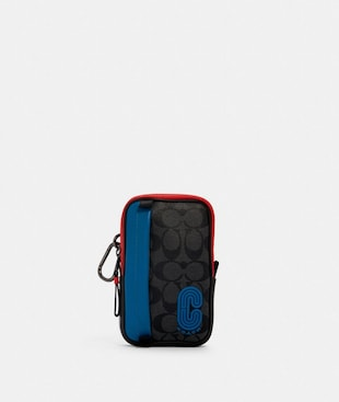 NORTH/SOUTH HYBRID POUCH IN COLORBLOCK SIGNATURE CANVAS WITH COACH PATCH