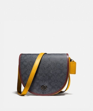 TURNLOCK SADDLE CROSSBODY IN SIGNATURE CANVAS