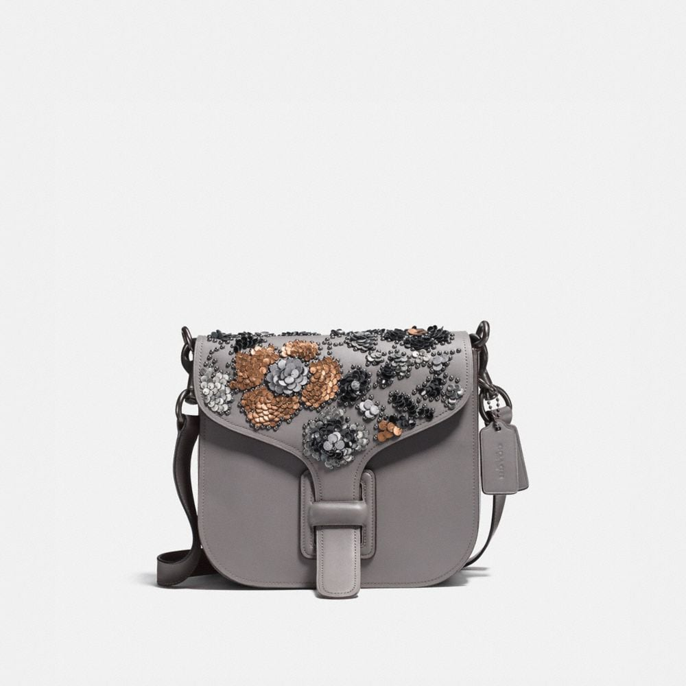 courier bag with leather sequins