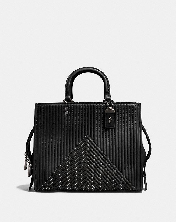 87bc636f63 Shoptagr | Rogue With Quilting And Rivets by Coach