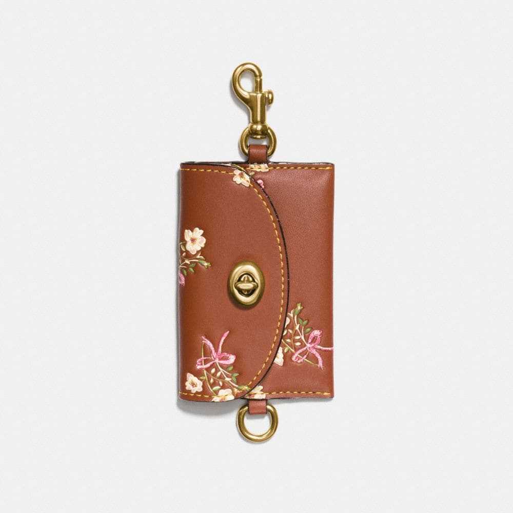 TURNLOCK CARD POUCH IN GLOVETANNED LEATHER WITH FLORAL BOW PRINT