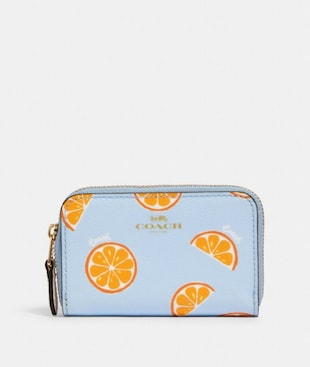 ZIP AROUND COIN CASE WITH ORANGE PRINT