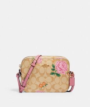 MINI CAMERA BAG IN SIGNATURE CANVAS WITH PRAIRIE ROSE PRINT