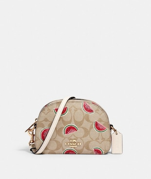 MINI SERENA CROSSBODY IN SIGNATURE CANVAS WITH WATERMELON PRINT
