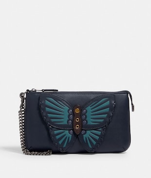 LARGE WRISTLET WITH BUTTERFLY APPLIQUE