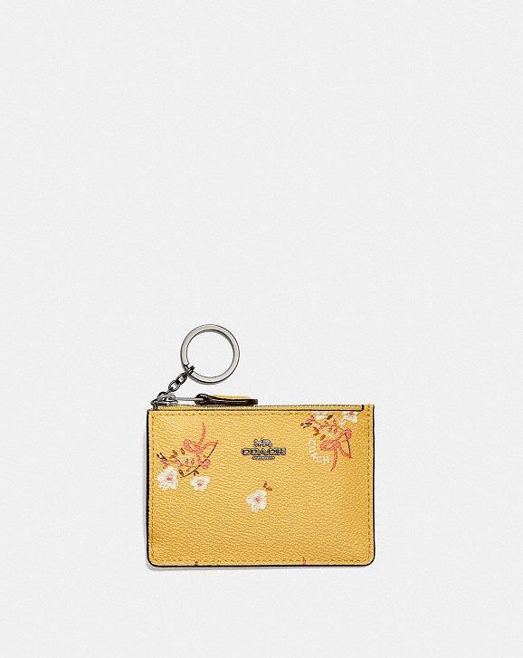 ed8df24db12ef Shoptagr | Mini Skinny Id Case With Floral Bow Print by Coach