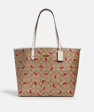 REVERSIBLE CITY TOTE IN SIGNATURE CANVAS WITH WATERMELON PRINT