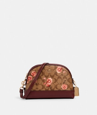 DOME CROSSBODY IN SIGNATURE CANVAS WITH PRAIRIE DAISY CLUSTER PRINT