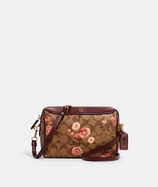 BENNETT CROSSBODY IN SIGNATURE CANVAS WITH PRAIRIE DAISY CLUSTER PRINT