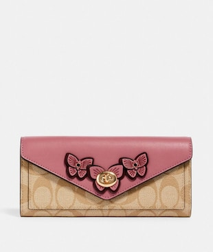 SLIM ENVELOPE WALLET IN SIGNATURE CANVAS WITH BUTTERFLY APPLIQUE