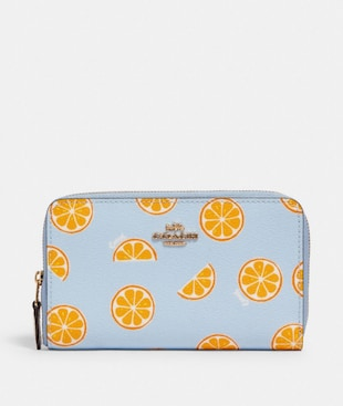 MEDIUM ZIP AROUND WALLET WITH ORANGE PRINT