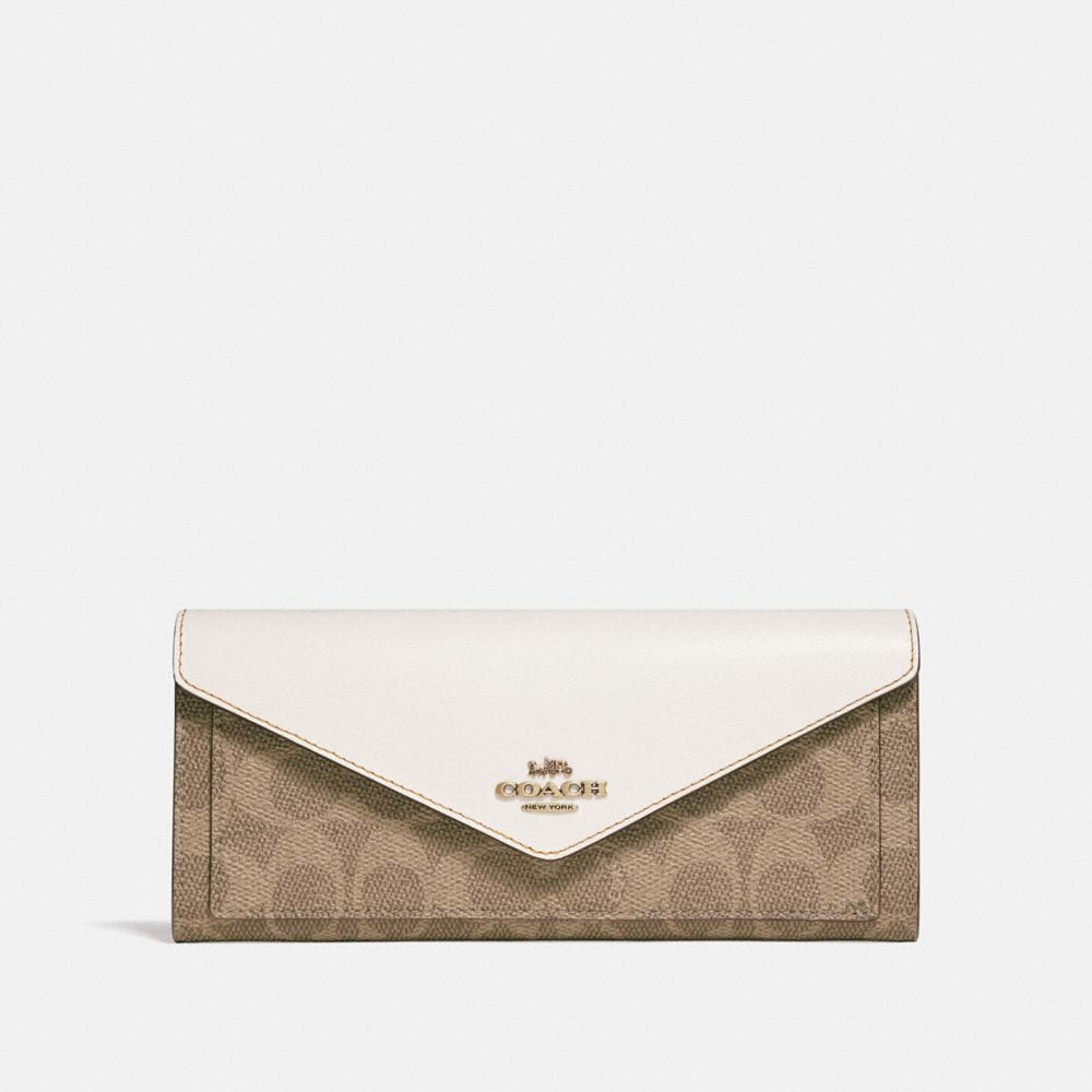Coach Envelope Wallet In Colorblock Signature Canvas With Tea Rose Turnlock Coach