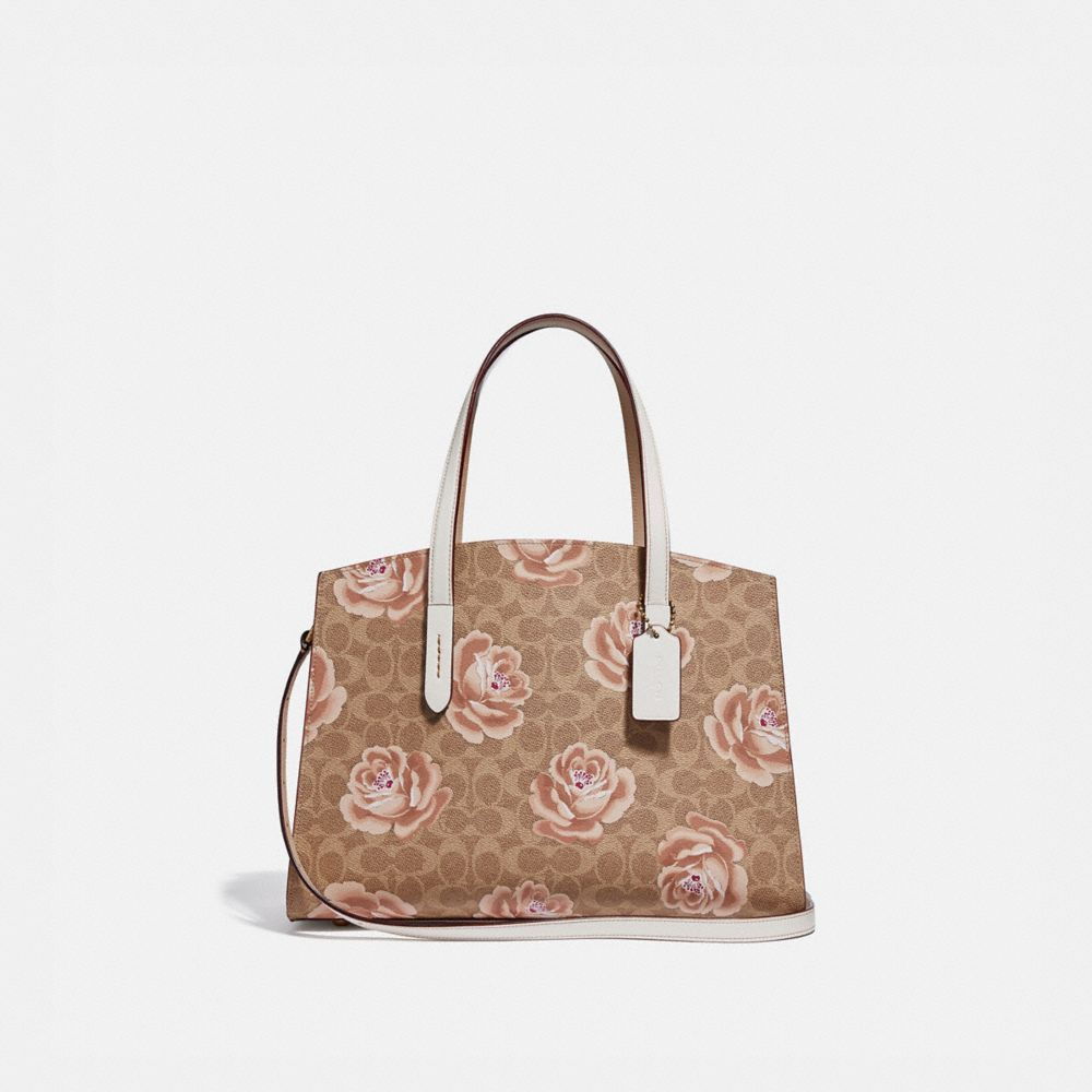 Coach Charlie Carryall in Signature Rose Print
