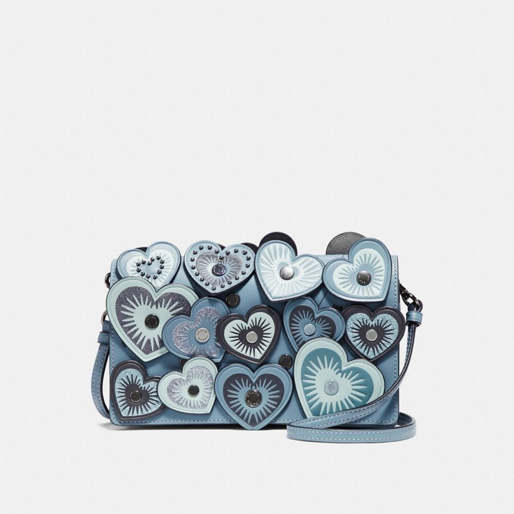 HAYDEN FOLDOVER CROSSBODY CLUTCH WITH HEARTS