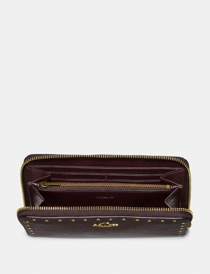 Coach Accordion Zip Wallet With Rivets Oxblood/Brass CYBER MONDAY SALE Women's Sale Wallets & Wristlets Alternate View 1