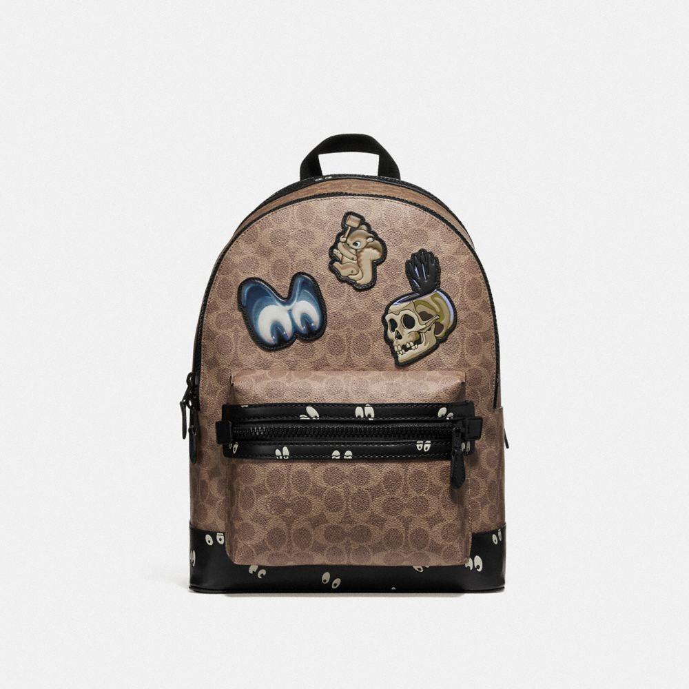 disney x coach academy backpack in signature patchwork