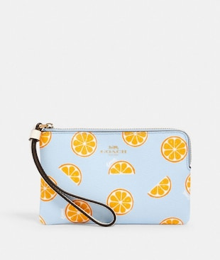 CORNER ZIP WRISTLET WITH ORANGE PRINT