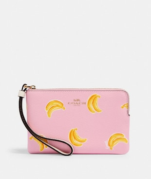 CORNER ZIP WRISTLET WITH BANANA PRINT