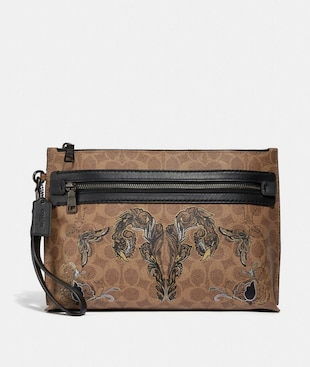 ACADEMY POUCH IN SIGNATURE CANVAS WITH TATTOO