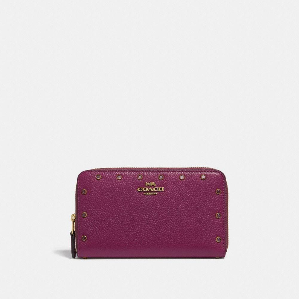 medium zip around wallet with crystal rivets