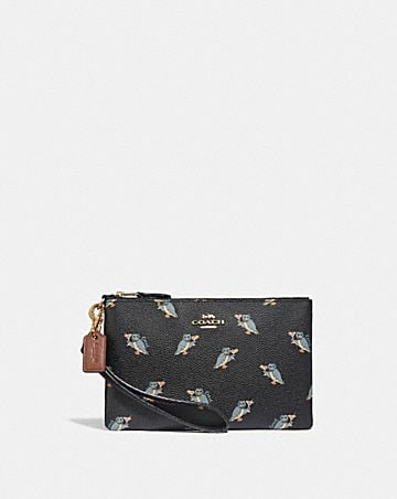 SMALL WRISTLET WITH PARTY OWL PRINT