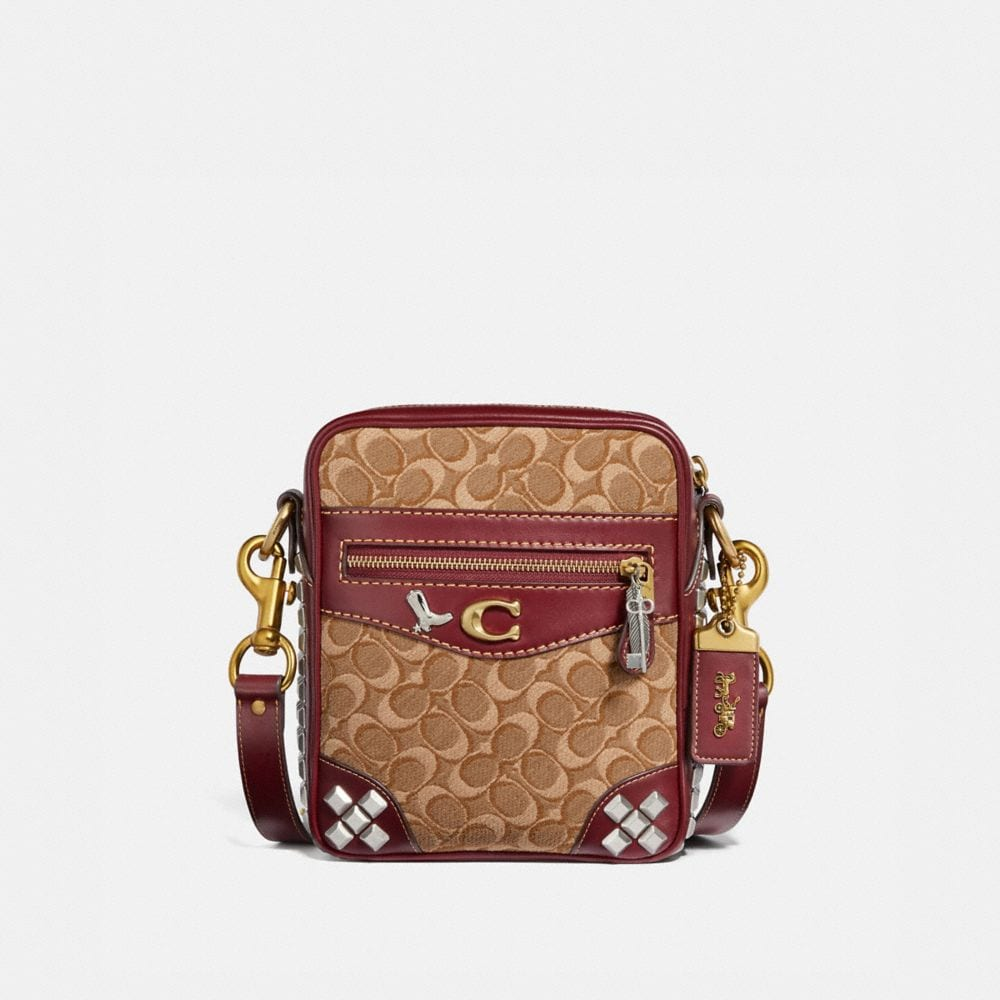 MAX CROSSBODY 18 IN SIGNATURE JACQUARD WITH PYRAMID RIVETS