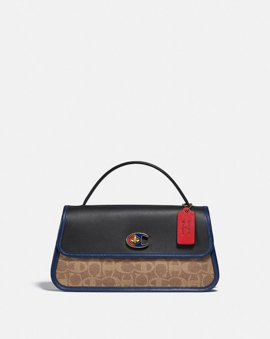 POCHETTE À TURNLOCK EN TOILE EXCLUSIVE COACH X CHAMPION