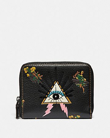 SMALL ZIP AROUND WALLET WITH PYRAMID EYE ...