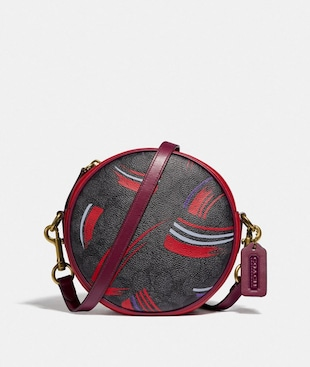 BUY NOW CIRCLE CROSSBODY IN SIGNATURE CANVAS WITH BRUSH STROKE PRINT