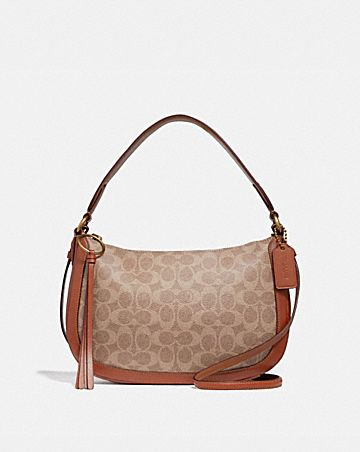 SUTTON CROSSBODY IN SIGNATURE CANVAS ... 966831440166e