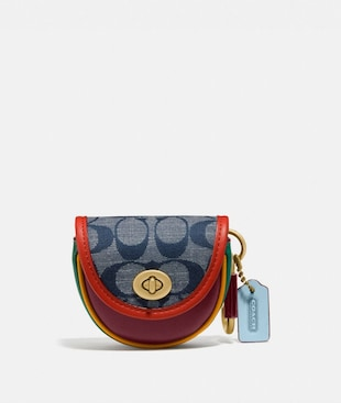 SADDLE BAG CHARM IN SIGNATURE CHAMBRAY