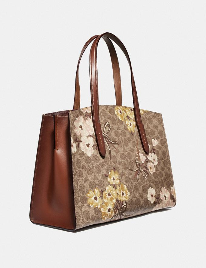 Coach Charlie Carryall in Signature Canvas With Prairie  Floral Print Tan/Rust Bow/Brass Women Bags Satchels & Carryalls Alternate View 1