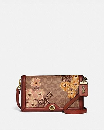 riley in signature canvas with prairie floral print