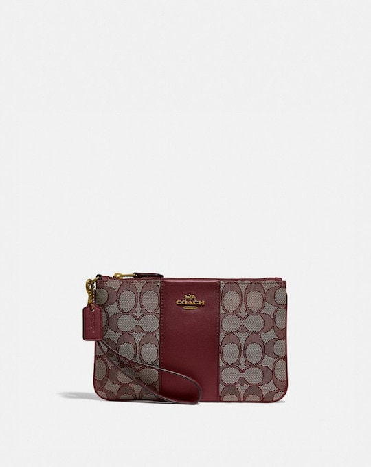 SMALL WRISTLET IN SIGNATURE JACQUARD
