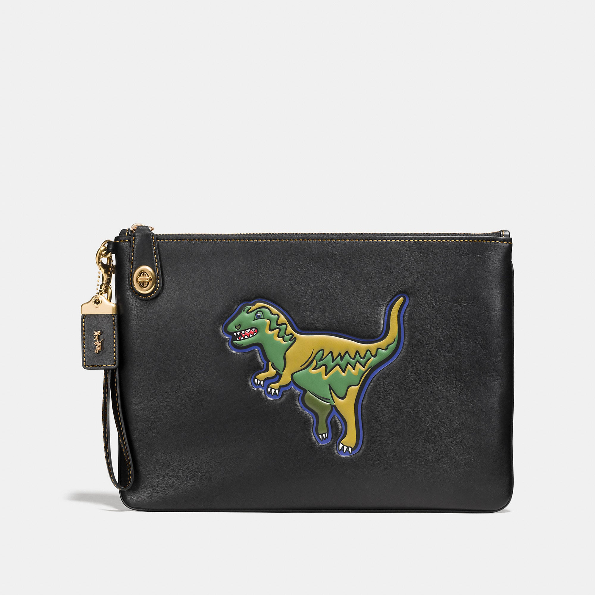 Coach Dinosaur Turnlock Wristlet 30 In Glovetanned Leather