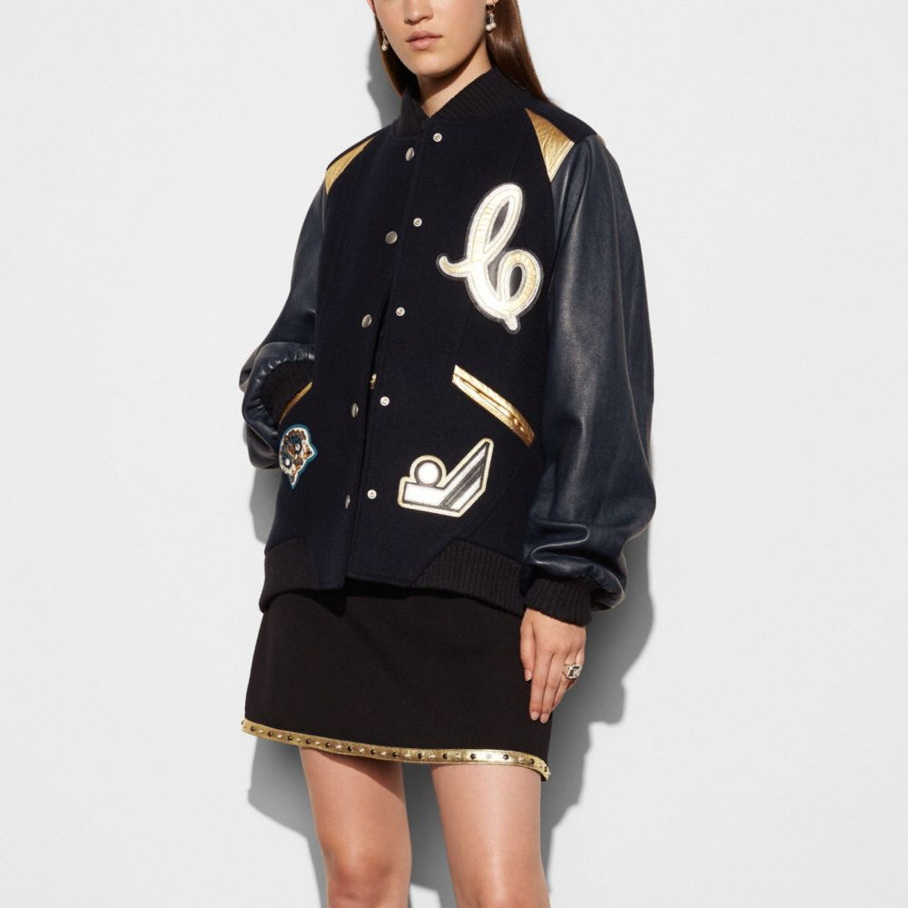 OVERSIZED VARSITY JACKET WITH METALLIC INSERTS
