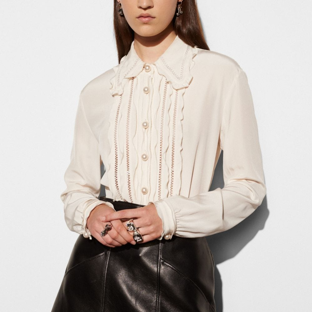 SHIRT WITH RUFFLE AND FAGOTTING