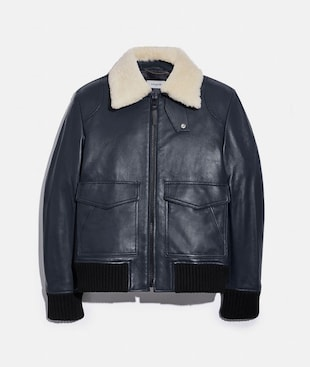 GIACCA BOMBER IN SHEARLING CON COLLETTO