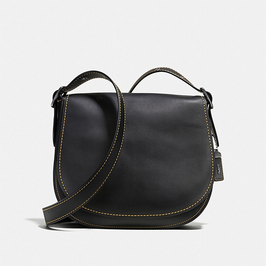 Beloved For Its Simple Functionality This Iconic Coach Design Has An Adjule Convertible Strap And Various Pockets Essentials Saddle
