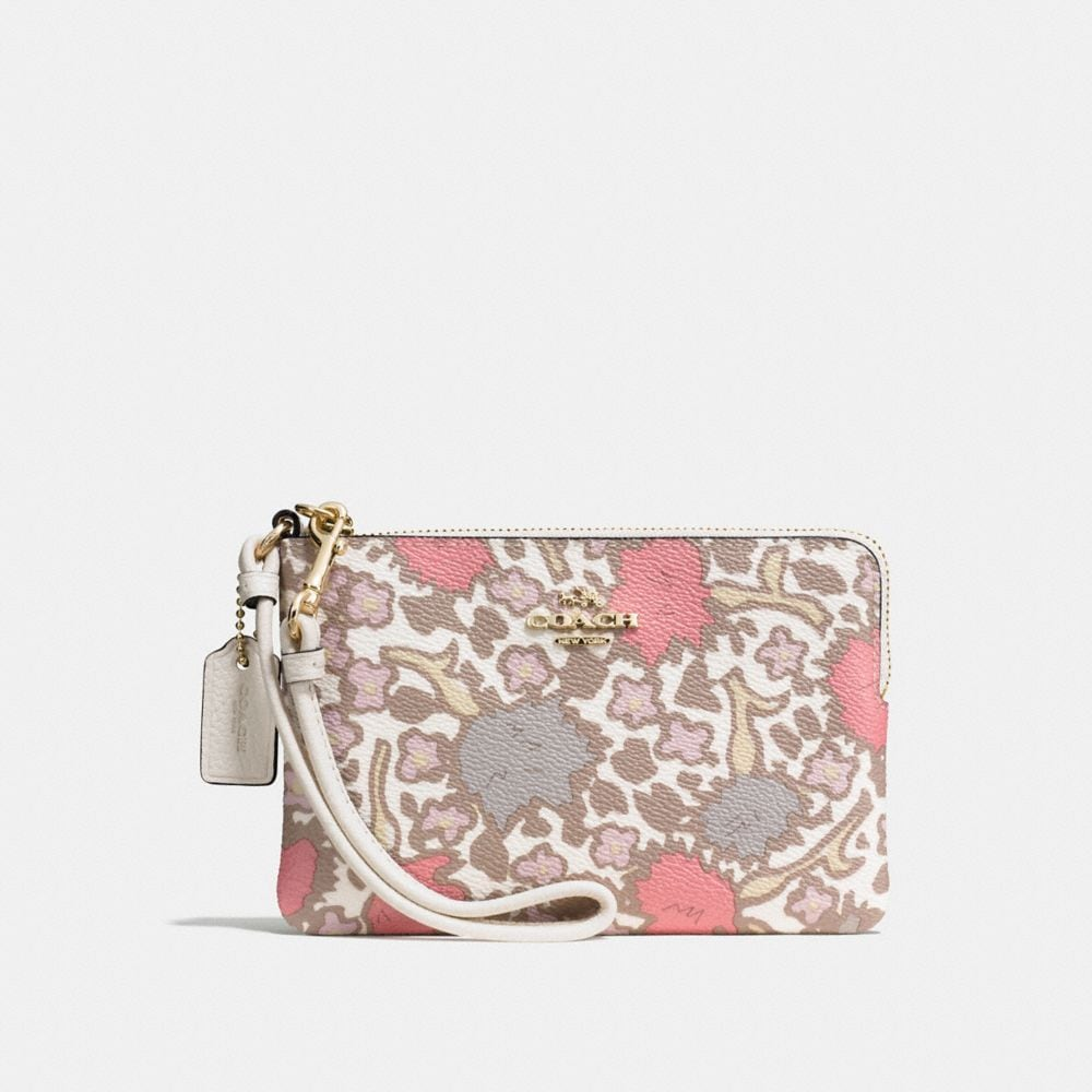 SMALL WRISTLET IN YANKEE FLORAL PRINT COATED CANVAS