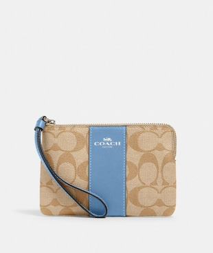 CORNER ZIP WRISTLET IN SIGNATURE CANVAS