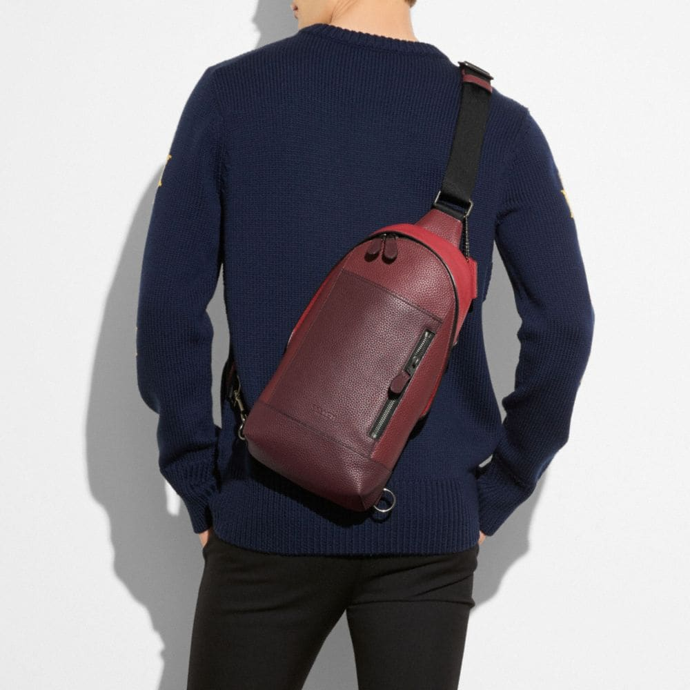COACH Manhattan Pack In Pebble Leather in Black Antique Nickel/Brick Red