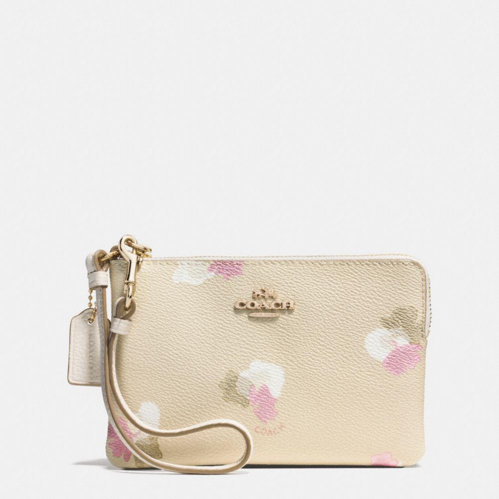 CORNER ZIP WRISTLET IN FLORAL PRINT COATED CANVAS