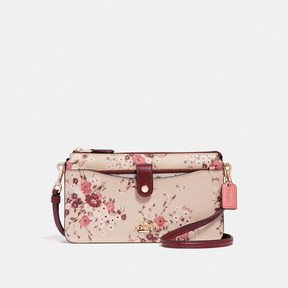 noa pop-up messenger with mixed floral print