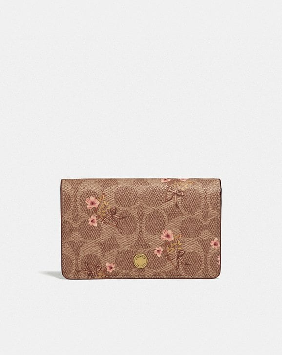 Coach FOLDOVER CARD CASE IN SIGNATURE CANVAS WITH FLORAL BOW PRINT