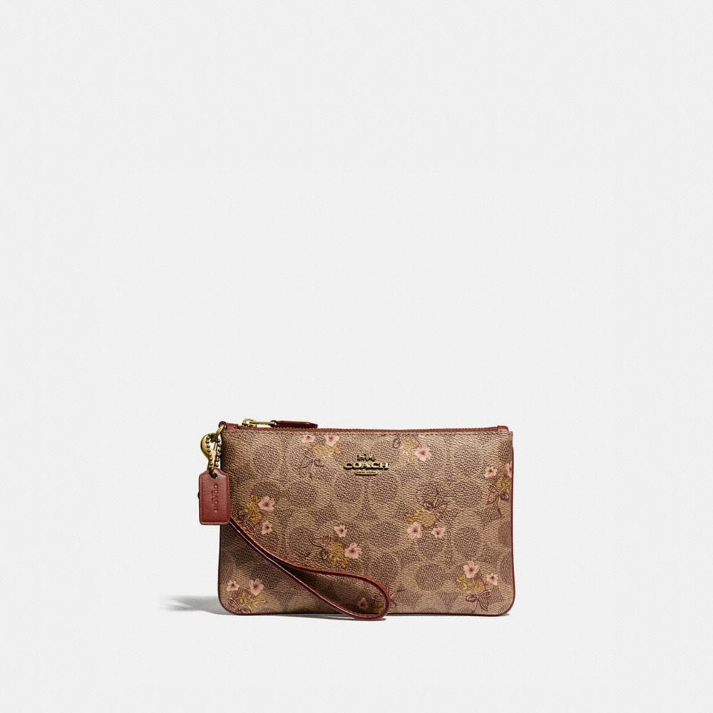 SMALL WRISTLET IN SIGNATURE CANVAS WITH FLORAL BOW PRINT