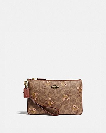 80eee7b1fea SMALL WRISTLET IN SIGNATURE CANVAS WITH FLORAL BOW PRINT ...