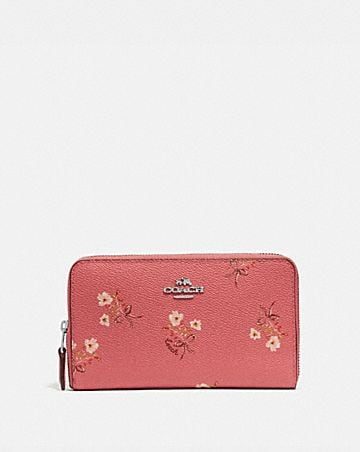 527e21af86a MEDIUM ZIP AROUND WALLET WITH FLORAL BOW PRINT