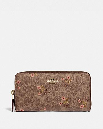 fc52bbd5f2992 ACCORDION ZIP WALLET IN SIGNATURE CANVAS WITH FLORAL BOW PRINT ...